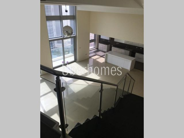 Stunning 3 BR Loft For Rent in Executive towers.